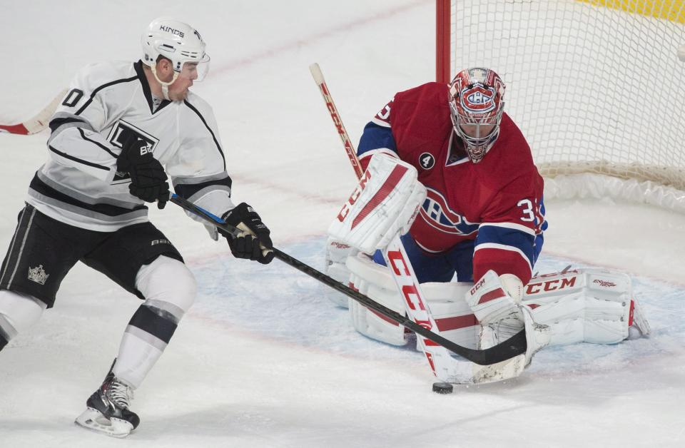 Montreal Canadiens goaltender Carey Price makes a save against Los Angeles Kings' Tanner Pearson during the first period of an NHL hockey game, Friday, Dec. 12, 2014 in Montreal. (AP Photo/Canadian Press, Graham Hughes)