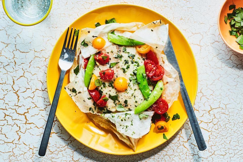 """To make things easy, put your entire Passover meal in a packet. The juicy burst tomatoes add a touch of sweetness to the fish. <a href=""""https://www.epicurious.com/recipes/food/views/fish-packets-with-snap-peas-tomatoes-and-herb-butter?mbid=synd_yahoo_rss"""" rel=""""nofollow noopener"""" target=""""_blank"""" data-ylk=""""slk:See recipe."""" class=""""link rapid-noclick-resp"""">See recipe.</a>"""