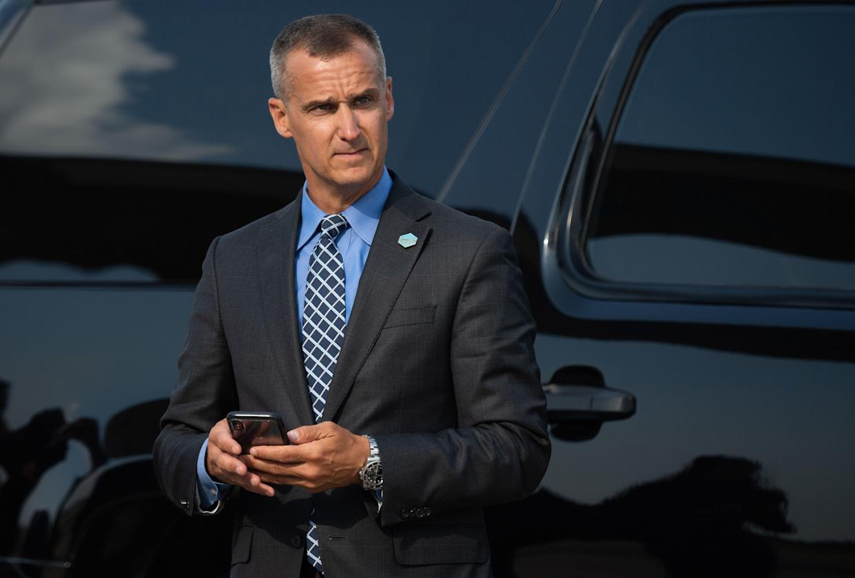 Corey Lewandowski, former campaign manager for President Donald Trump, watches as Trump disembarks from Air Force One upon arrival at Cincinnati/Northern Kentucky International Airport on Aug. 1.