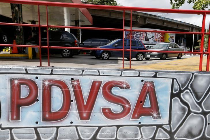 Cars wait the line at a PDVSA gas station in Caracas