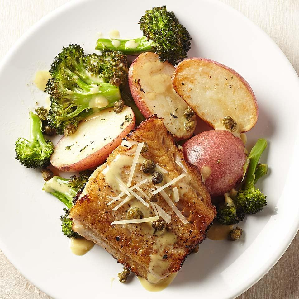 "<p>In this healthy, 30-minute fish recipe, cooking the fillets skin-side down makes it easy to keep them intact when you flip them. Be sure to pat the fish dry before cooking--it's the key to getting the skin crispy. <a href=""http://www.eatingwell.com/recipe/255159/lemon-caper-black-cod-with-broccoli-potatoes/"" rel=""nofollow noopener"" target=""_blank"" data-ylk=""slk:View recipe"" class=""link rapid-noclick-resp""> View recipe </a></p>"