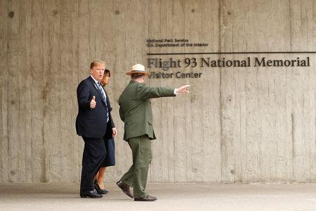 U.S. President Donald Trump and first lady Melania Trump walk with park superintendent Stephen Clark at the Flight 93 National Memorial during the 17th annual September 11 observance at the memorial near Shanksville, Pennsylvania, U.S., September 11, 2018. REUTERS/Kevin Lamarque