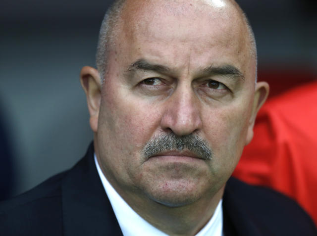 Russia's head coach Stanislav Cherchesov waits for the start of a friendly soccer match between Russia and Turkey at the VEB Arena stadium in Moscow, Russia, Tuesday, June 5, 2018. (AP Photo/Pavel Golovkin)
