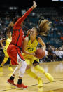 Oregon's Sabrina Ionescu, right, drives around Arizona's Tee Tee Starks during the second half of an NCAA college basketball game at the Pac-12 women's tournament Friday, March 8, 2019, in Las Vegas. (AP Photo/John Locher)