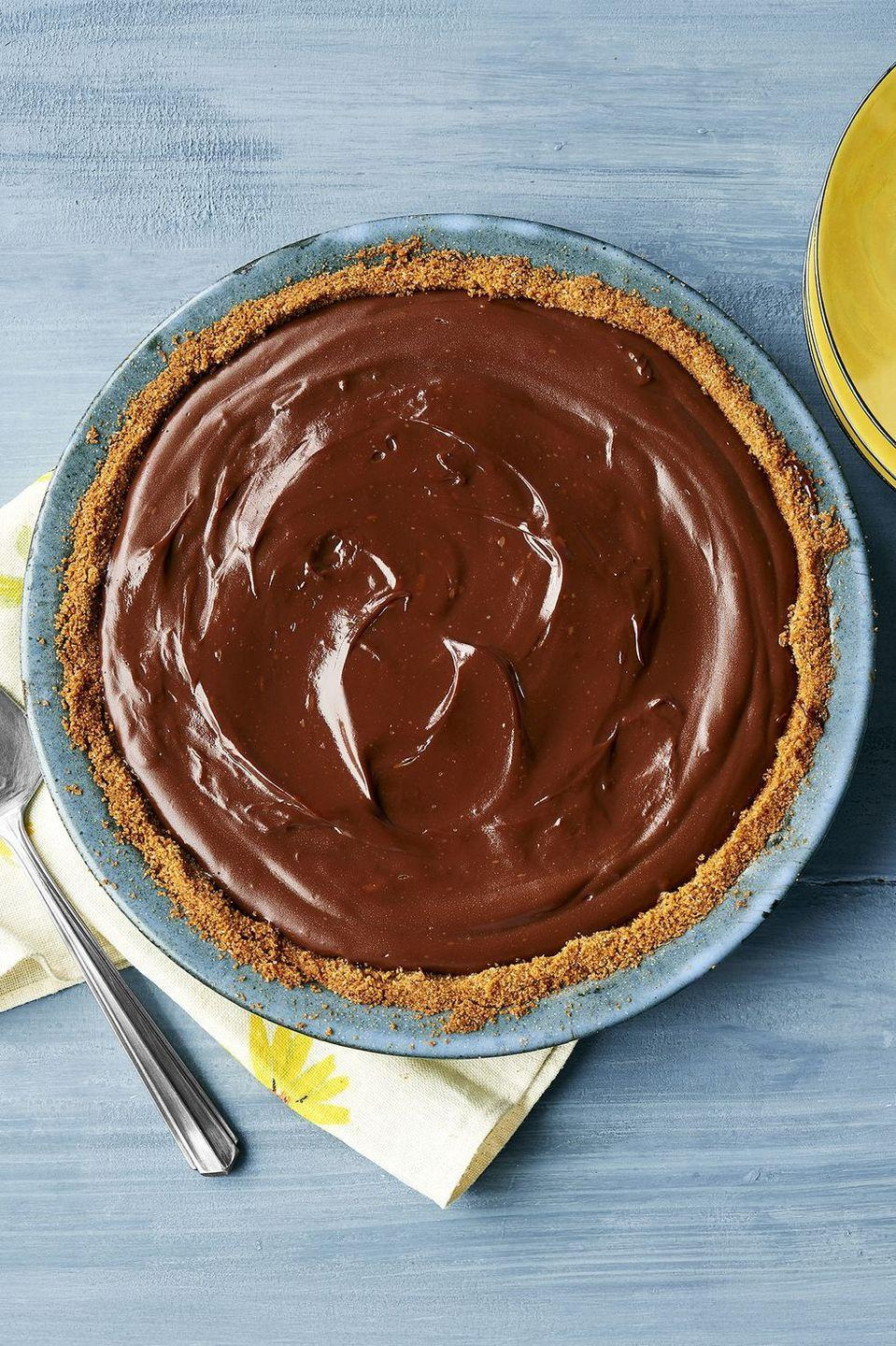 """<p>Chocolate lovers will go crazy for this decadent chocolate pudding pie. You can even customize it by using traditional pie crust, graham cracker crust, or Oreo crumbs. </p><p><a href=""""https://www.thepioneerwoman.com/food-cooking/recipes/a11850/chocolate-pie/"""" rel=""""nofollow noopener"""" target=""""_blank"""" data-ylk=""""slk:Get Ree's recipe."""" class=""""link rapid-noclick-resp""""><strong>Get Ree's recipe. </strong></a></p><p><a class=""""link rapid-noclick-resp"""" href=""""https://go.redirectingat.com?id=74968X1596630&url=https%3A%2F%2Fwww.walmart.com%2Fsearch%2F%3Fquery%3Dpioneer%2Bwoman%2Bsaucepan&sref=https%3A%2F%2Fwww.thepioneerwoman.com%2Ffood-cooking%2Fmeals-menus%2Fg36558208%2Fsummer-pie-recipes%2F"""" rel=""""nofollow noopener"""" target=""""_blank"""" data-ylk=""""slk:SHOP SAUCEPANS"""">SHOP SAUCEPANS</a></p>"""