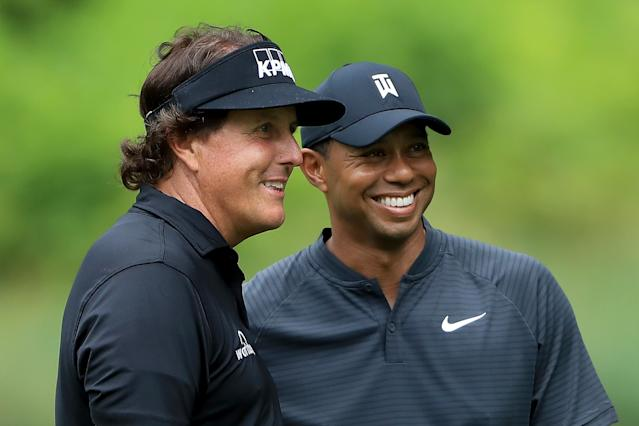 "<h1 class=""title"">World Golf Championships-Bridgestone Invitational - Preview Day 3</h1> <div class=""caption""> Phil Mickelson and <a class=""link rapid-noclick-resp"" href=""/pga/players/147/"" data-ylk=""slk:Tiger Woods"">Tiger Woods</a> smile during a practice round prior to the World Golf Championships-Bridgestone Invitational at Firestone Country Club. </div> <cite class=""credit"">(Photo by Sam Greenwood/Getty Images)</cite>"