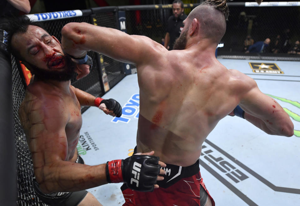 LAS VEGAS, NEVADA - MAY 01: (R-L) Jiri Prochazka of the Czech Republic knocks out Dominick Reyes in a light heavyweight bout during the UFC Fight Night event at UFC APEX on May 01, 2021 in Las Vegas, Nevada. (Photo by Jeff Bottari/Zuffa LLC)