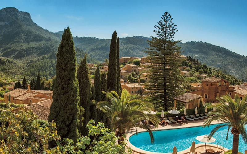 A maze of stone stairs threads through the buildings towards the sun-soaked pool-scape at Belmond La Residencia.