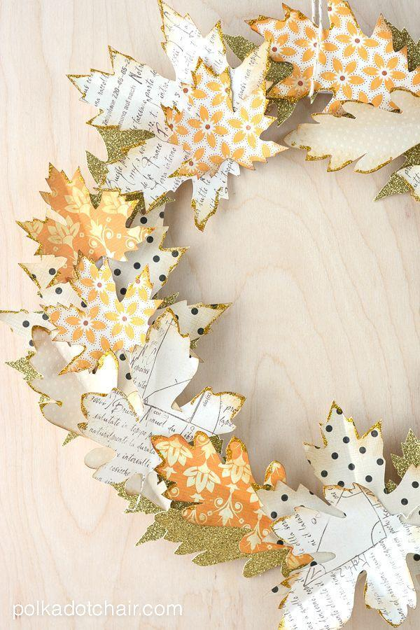 """<p> This delicate wreath is all about the details: use distress ink and gold glitter glue on each leaf for a stunning, one-of-a-kind display.</p><p><strong>Get the tutorial at <a href=""""https://www.polkadotchair.com/autumn-paper-leaf-craft-ideas/"""" rel=""""nofollow noopener"""" target=""""_blank"""" data-ylk=""""slk:Polkadot Chair."""" class=""""link rapid-noclick-resp"""">Polkadot Chair.</a></strong> </p>"""