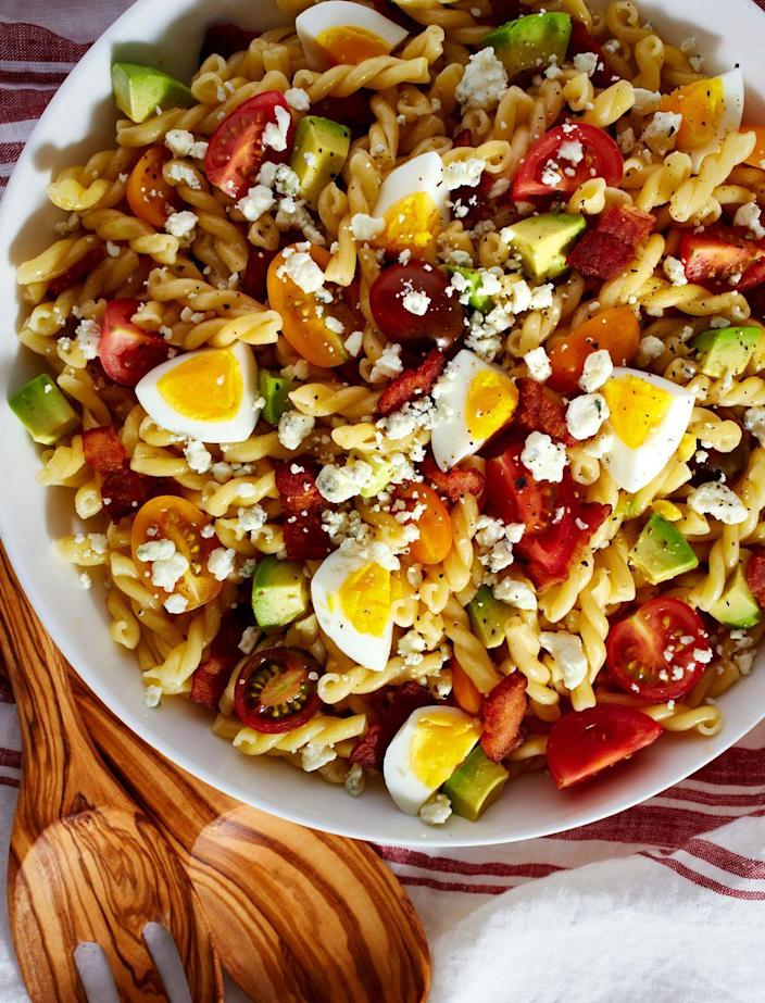 """<p>Your lunchtime favorite: pasta-ified.</p><p>Get the recipe from <a href=""""https://www.delish.com/cooking/recipe-ideas/recipes/a47989/cobb-pasta-salad-recipe/"""" rel=""""nofollow noopener"""" target=""""_blank"""" data-ylk=""""slk:Delish"""" class=""""link rapid-noclick-resp"""">Delish</a>.</p>"""