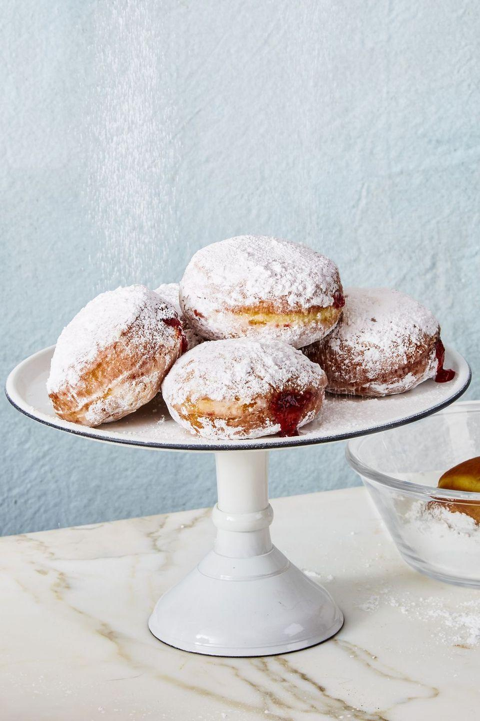 "<p>These filled donuts are the most traditional among Hanukkah desserts. They are typically filled with jelly or custard, and are light, airy, and positively addictive. This recipe uses raspberry or strawberry jam for a classic filling, and is rolled in confectioners sugar for a tempting presentation.</p><p><em><a href=""https://www.goodhousekeeping.com/food-recipes/a48180/classic-jelly-donuts-recipe/"" rel=""nofollow noopener"" target=""_blank"" data-ylk=""slk:Get the recipe for jelly donuts"" class=""link rapid-noclick-resp"">Get the recipe for jelly donuts</a></em></p>"