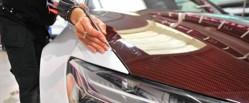 A car wrap being applied