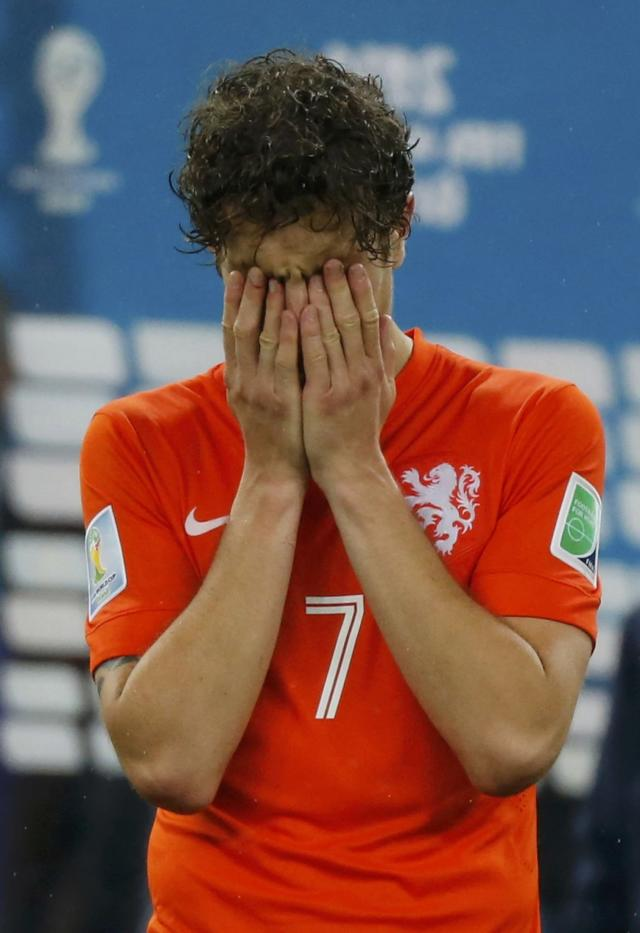 Daryl Janmaat of the Netherlands reacts to his team's loss to Argentina after their 2014 World Cup semi-finals at the Corinthians arena in Sao Paulo July 9, 2014. REUTERS/Sergio Moraes (BRAZIL - Tags: SOCCER SPORT WORLD CUP)