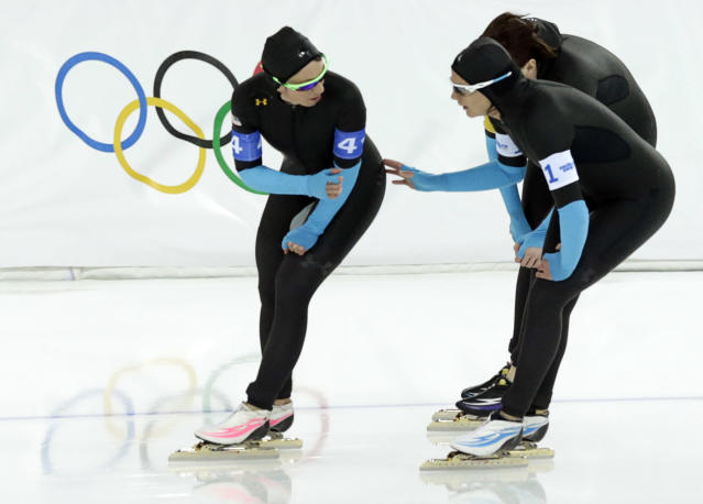 U.S. speedskaters Jilleanne Rookard, left, Brittany Bowe, front right, and Heather Richardson catch their breath after the women's speedskating team pursuit quarterfinals at the Adler Arena Skating Center at the 2014 Winter Olympics, Friday, Feb. 21, 2014, in Sochi, Russia. (AP Photo/Matt Dunham)