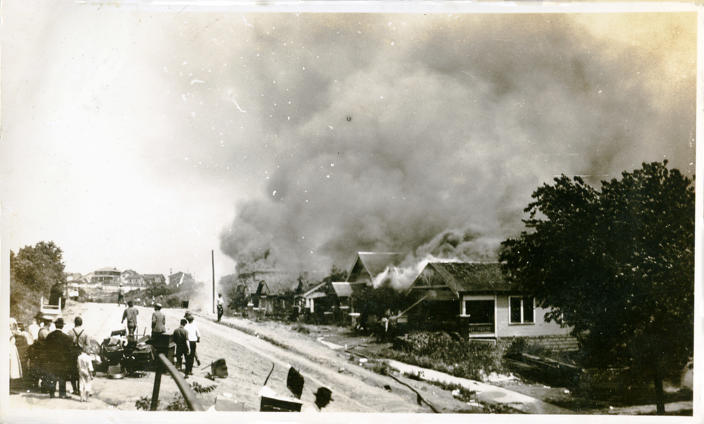 A group of people looking at smoke in the distance coming from damaged properties following the Tulsa Race Massacre, Tulsa, Oklahoma, June 1921. (Oklahoma Historical Society/Getty Images)