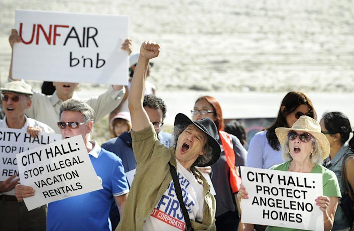 """Venice residents, advocates and affordable housing supporters rally in 2015 calling for regulation of short-term rentals. <span class=""""copyright"""">(Christina House / Los Angeles Times)</span>"""