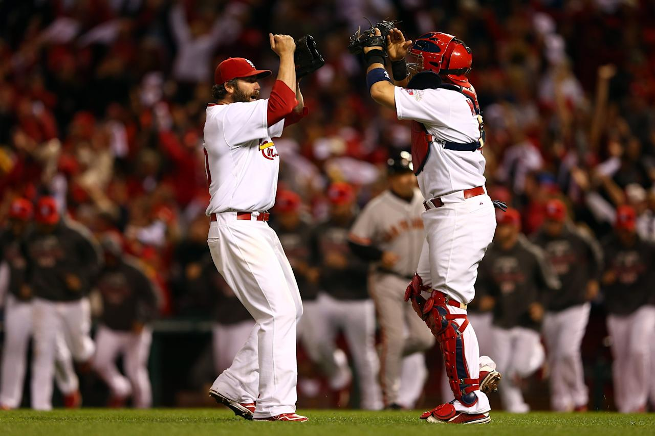 ST LOUIS, MO - OCTOBER 17:  Jason Motte #30 and catcher Yadier Molina #4 of the St. Louis Cardinals celebrate the Cardinals 3-1 victory against the San Francisco Giants in Game Three of the National League Championship Series at Busch Stadium on October 17, 2012 in St Louis, Missouri.  (Photo by Elsa/Getty Images)