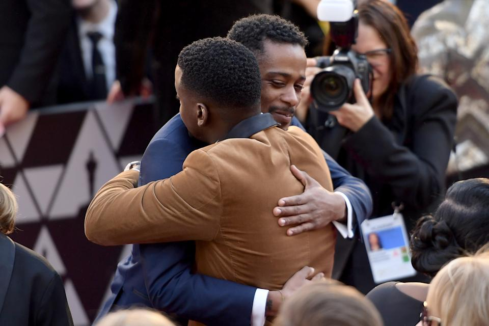 Lakeith Stanfield and Daniel Kaluuya embrace at the 90th Annual Academy Awards on March 4, 2018. (Photo by Matt Winkelmeyer/Getty Images)