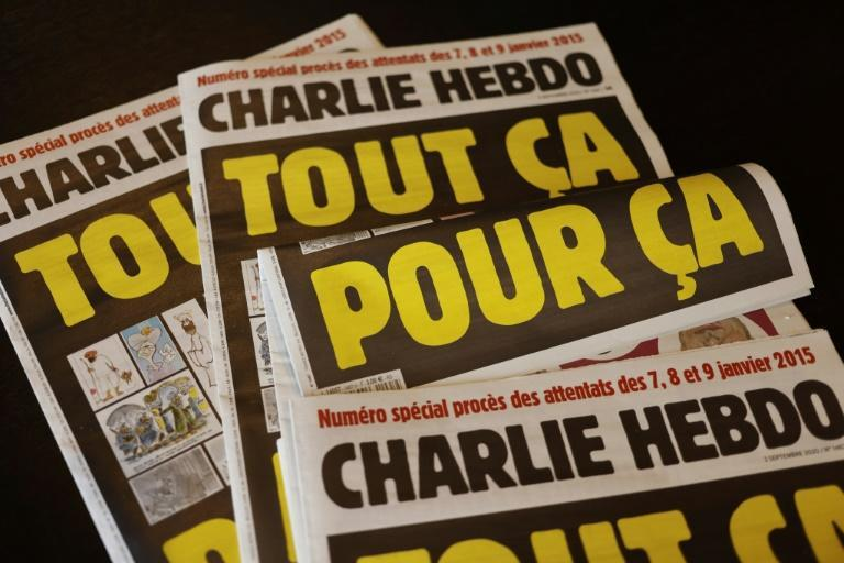 """French satirical weekly Charlie Hebdo (cover pictured September 1, 2020, reading """"All of this, just for that"""" republished controversial cartoons of the Prophet Mohammed, drawing threats from Al-Qaeda"""