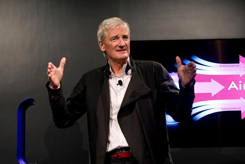 FILE - In this Wednesday, Sept., 14, 2011 file photo, Inventor James Dyson launches the Dyson DC41 Ball vacuum and the Dyson Hot heater fan on in New York. Dyson, the British company best known for innovative vacuum cleaners, has said on Tuesday, Oct. 23, 2018 it will build its electric car in Singapore. The company says the bespoke manufacturing facility is due for completion in 2020 and is part of a 2.5 billion pound ($3.2 billion) investment in new technology globally. (AP Photo/Rob Bennett, file)