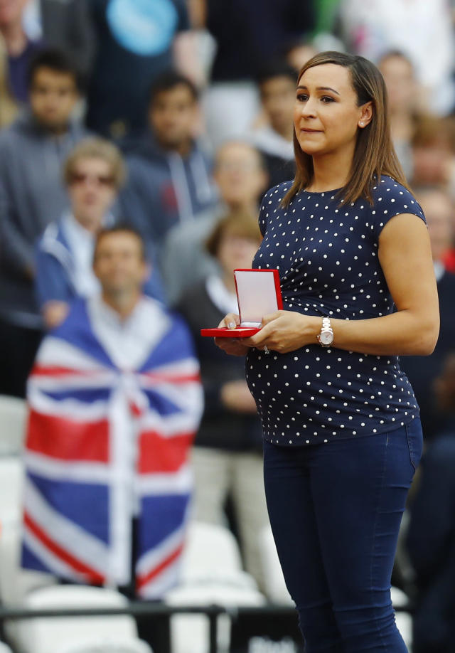 Athletics - World Athletics Championships - Men's 100 Metre Final – London Stadium, London, Britain - August 6, 2017. Jessica Ennis-Hill presents a medal. REUTERS/Kai Pfaffenbach