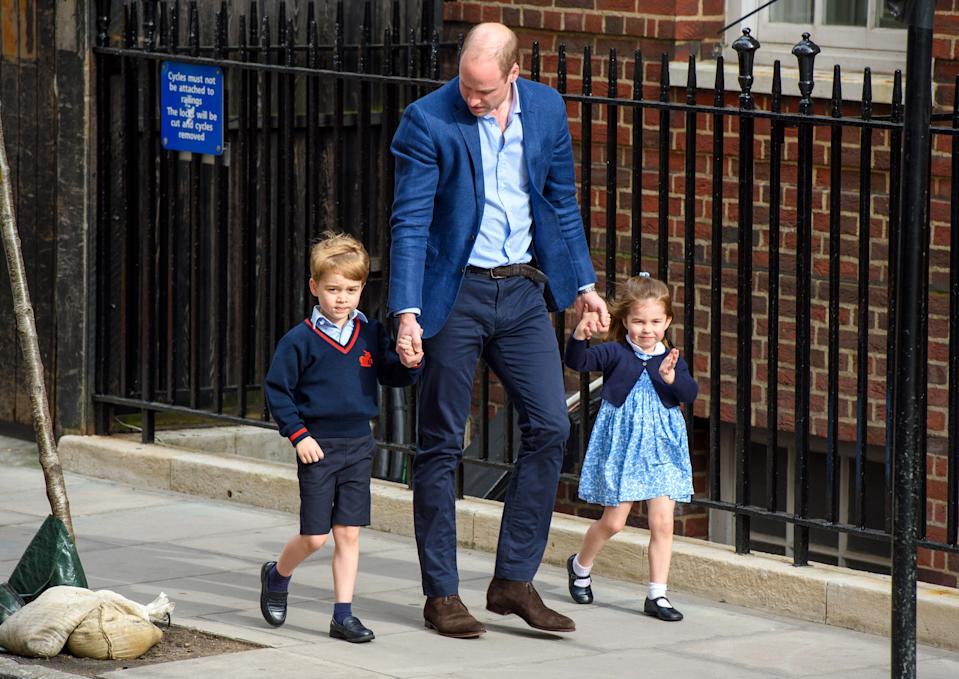 The Duke of Cambridge with Prince George and Princess Charlotte outside the Lindo Wing at St Mary's Hospital in Paddington, London. Photo credit should read: Matt Crossick/EMPICS Entertainment