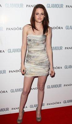When: 2011 <br>Where: Glamour Women of the Year Awards <br>Wearing: Balmain nude mini dress