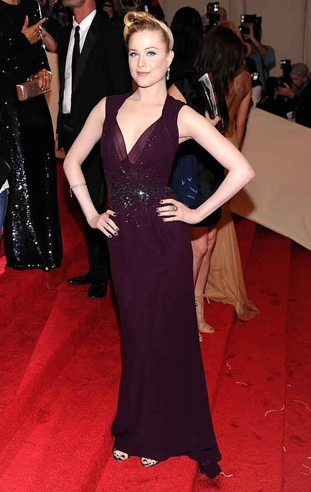 "Evan Rachel Wood played up a plum-colored Gucci Premiere gown and upswept hairdo. Dimitrios Kambouris/<a href=""http://www.filmmagic.com/"" target=""new"">FilmMagic.com</a> - May 2, 2011"