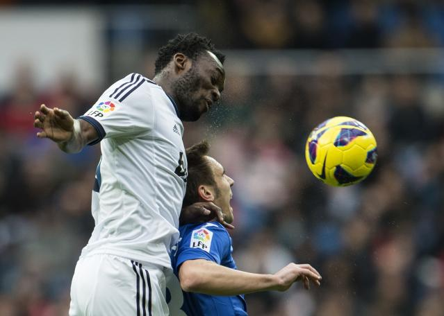 Real Madrid's Ghanaian midfielder Michael Essien (L) vies with Getafe's midfielder Pablo Sarabia during the Spanish league football match Real Madrid vs Getafe at the Santiago Bernabeu stadium in Madrid on January 27, 2013. AFP PHOTO / DANI POZODANI POZO/AFP/Getty Images