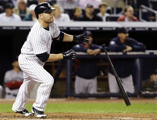 New York Yankees' Russell Martin watches his second-inning, solo home run off Boston Red Sox starting pitcher Clay Buchholz during their baseball game at Yankee Stadium in New York, Monday, Oct. 1, 2012. (AP Photo/Kathy Willens)
