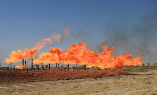 <p>Flames emerge from flare stacks at the oil fields in Kirkuk, Iraq, Oct. 18, 2017. (Photo: Alaa Al-Marjani/Reuters) </p>