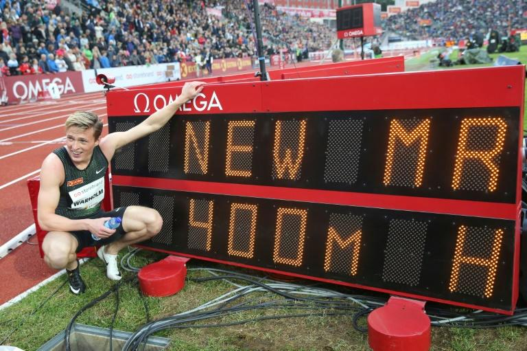 Norway´s Karsten Warholm poses next to the result board after winning the Men´s 400m Hurdles during the IAAF Athletics Diamond League competition on June 13, 2019 at the Bislett Stadium in Oslo, Norway
