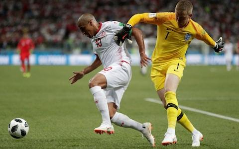 England saw off Tunisia 2-1 in their first World Cup 2018 match, with Harry Kane scoring twice to clinch a win when a dispiriting draw had begun to look inevitable. How did the two teams fare in Volgograd? Ben Rumsby was watching attentively. Tunisia Mouez Hassen:Packed enough drama into his 15 minutes on the field for an entire match, producing two brilliant reflex saves. An early injury ultimately told. 5 Yassine Meriah: Struggled to contain Ashley Young in the first half but did so after the break. Showed little going the other way. 6 Syam Ben Youssef: Looked like being overrun in the first half but increasingly comfortable after the break up against a fading Harry Kane and Raheem Sterling. 6 Dylan Bronn: One excellent tackle to deny Kane after growing in confidence as the game wore on but all his work went to waste. 6 Tunisia defender Dylan Bronn (L) holds off Dele Alli Credit: AFP Ali Maaloul:Not really tested by Kieran Trippier but neither did he give the Tottenham Hotspur full-back a headache at the other end. 6 Ellyes Skhiri: Montpellier midfielder did most of his work in his own half and rarely threatened going forward. 6 Anice Badri: Joined in the rearguard effort as England huffed and puffed for a winner that eventually came. 6 Ferjani Sassi:Penalty struck just hard enough to beat Jordan Pickford but might have not to give one away straight after for wrestling Kane to the ground. 6 Ferjani Sassi celebrates his first-half goal Credit: AP Fakhreddine Ben Youssef:Tunisia's best player. Won their penalty, sent a header wide and generally a thorn in England's side throughout. 7 Wahbi Khazri: The on-loan Sunderland man was denied the pleasure out of frustrating England players who helped end his Premier League career. 5 Naim Sliti: Dijon forward blazed one shot over after a nice turn but was otherwise an isolated figure as England dominated possession and territory. 5 Wahbi Khazri (L) nips in ahead of Jordan Pickford Credit: REUTERS England: Jordan Pickford:So close to keeping out Sassi's penalty and did not have another save to make. Distribution, supposedly his great strength, not always spot on. 6 Kyle Walker: Brainless foul on Fakhreddine Ben Youssef to give away a penalty, casting doubt on the decision to play him at centre-back. 5 John Stones: Fumbled a shot from close range but instrumental in Kane's opener when his towering header forced a rebound. Seemed rusty after such little game time at Manchester City. 6 Kyle Walker gave away a first-half penalty Credit: REUTERS Harry Maguire:Flick-on set up Kane's winner in a vastly-improved second-half display by the defender, who looked totally out of his depth on the rare occasions Tunisia threatened in the first. 6 Kieran Trippier:Corner set up Kane's winner in a game where most of England's play came down the left, restricting what he could do going forward. 7 Jordan Henderson: A Jekyll-and-Hyde performance on the ball and saw one fierce shot beaten away. Will need help in midfield against better teams. 6 England 2-1 Tunisia | Did Southgate's big calls pay off? Ashley Young:Corner set up the opener and he saw plenty of the ball. But England's lack of a left-foot option will not help him keep Danny Rose out of the team. 7 Raheem Sterling: Not his night. Missed an open goal, could not keep hold of the ball and ran down blind alleys. Needs a big performance against Panama - if he starts. 5 Dele Alli: Bravely soldiered on after picking up a knock that looked certain to end his game but could not reproduce what had been some great play early on. 6 Harry Kane (R) scores his first goal at a major tournament Credit: PA Jesse Lingard:Seemingly cursed not to score in the first half. Had one decent finish saved, saw another deflected over and a third hit the post. 7 Harry Kane: Rescued England again with a stoppage-time winner after taking less than 11 minutes to score on his World Cup debut. If only every chance fell to him. 8
