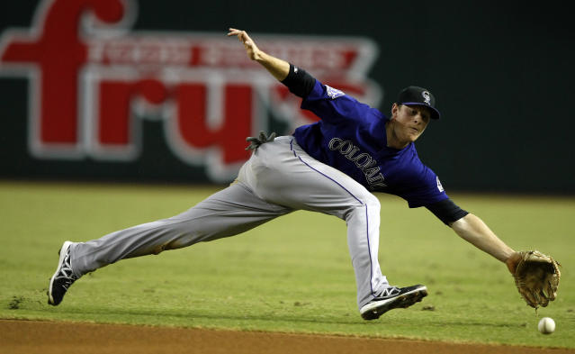 Colorado Rockies second baseman DJ LeMahieu for the ball in the fourth inning of a baseball game against the Arizona Diamondbacks, Saturday, Sept. 14, 2013, in Phoenix. (AP Photo/Rick Scuteri)
