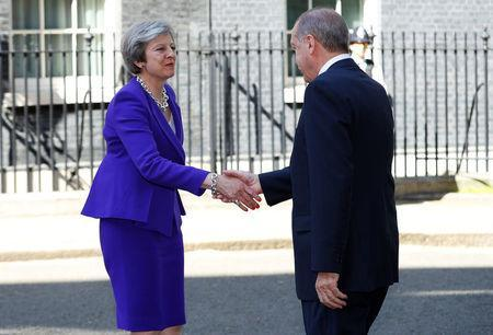 Britain's Prime Minister Theresa May greets Turkey's President Recep Tayyip Erdogan outside 10 Downing Street in London, May 15, 2018. REUTERS/Phil Noble