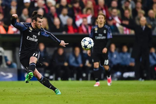 Real Madrid's Welsh forward Gareth Bale in action during the UEFA Champions League 1st leg quarter-final football match FC Bayern Munich v Real Madrid in Munich, southen Germany on April 12, 2017 (AFP Photo/GUENTER SCHIFFMANN)