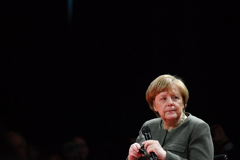 Chancellor Angela Merkel said Germany would lift defence spending but not at the cost of development aid, rejecting US criticism