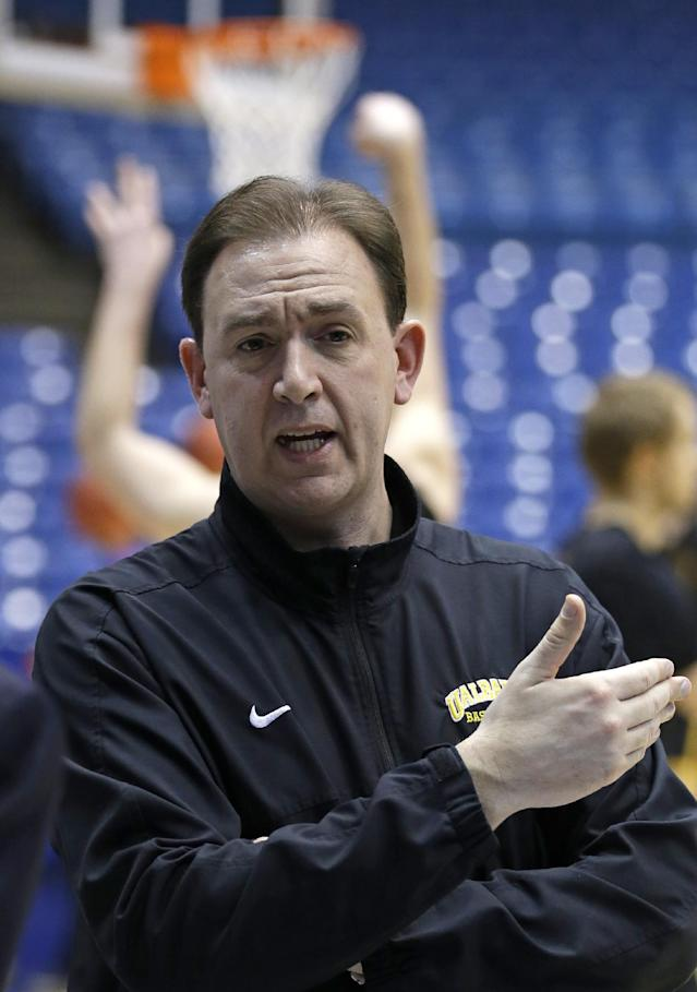 Albany head coach Will Brown is interviewed during practice for an NCAA college basketball tournament game, Monday, March 17, 2014, in Dayton, Ohio. Albany plays Mount St. Mary's Tuesday evening in a first round game. (AP Photo/Al Behrman)
