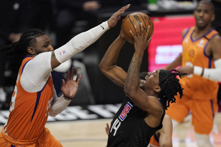 Los Angeles Clippers guard Terance Mann, center, shoots as Phoenix Suns forward Jae Crowder, left, defends during the second half in Game 6 of the NBA basketball Western Conference Finals Wednesday, June 30, 2021, in Los Angeles. (AP Photo/Mark J. Terrill)