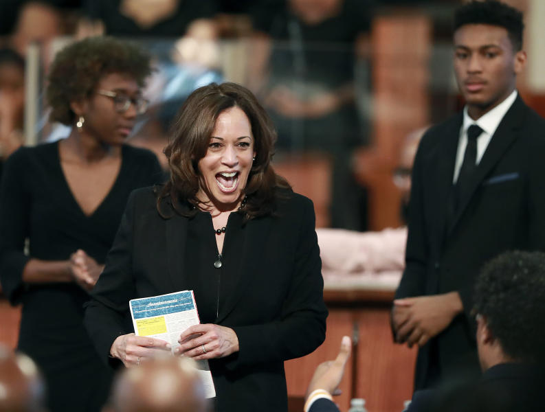 U.S. Sen. Kamala Harris, D-Calif., reacts to the crowd after making special remarks during the worship service at Ebenezer Baptist Church on Sunday, March 24, 2019, in Atlanta. The Democratic presidential candidate is one of several candidates to visit Georgia in the 2020 cycle. (Curtis Compton/Atlanta Journal-Constitution via AP)