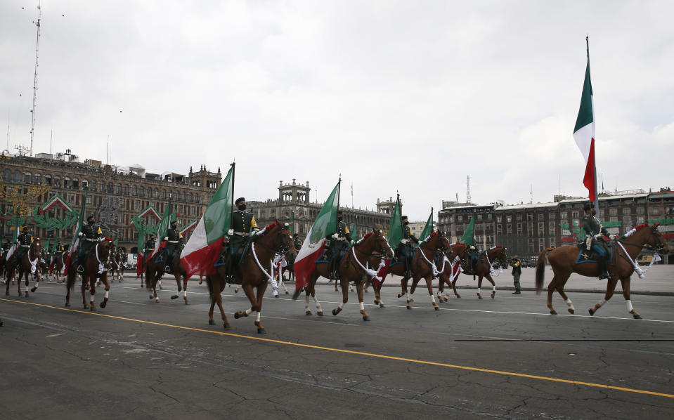 Mounted troops participate in the annual Independence Day military parade in Mexico City's main square of the capital, the Zócalo, Wednesday, Sept. 16, 2020. Mexico celebrates the anniversary of its independence uprising of 1810. ( AP Photo/Marco Ugarte)