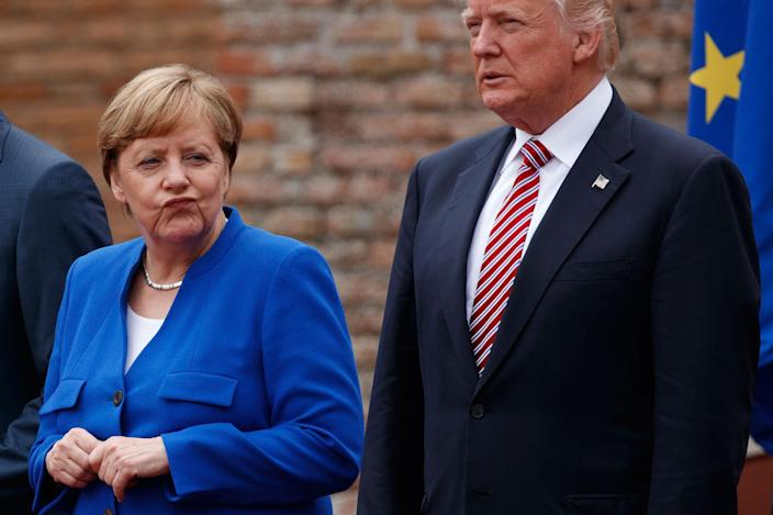 <p>German Chancellor Angela Merkel and President Donald Trump pose for a family photo with G7 leaders at the Ancient Greek Theater of Taormina, Friday, May 26, 2017, in Taormina, Italy. (Photo: Evan Vucci/AP) </p>