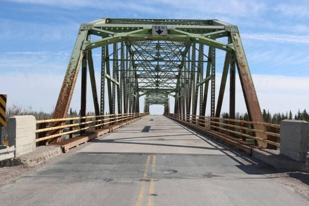 A photo of the Frank Channel Bridge. It was close to here that a man was reported to have gone into the water below.  (Kirsten Fenn/CBC - image credit)