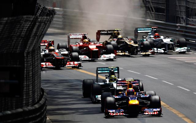 MONTE CARLO, MONACO - MAY 27: Mark Webber of Australia and Red Bull Racing leads Nico Rosberg of Germany and Mercedes GP after the start of the Monaco Formula One Grand Prix at the Circuit de Monaco on May 27, 2012 in Monte Carlo, Monaco. (Photo by Vladimir Rys Photography via Getty Images)