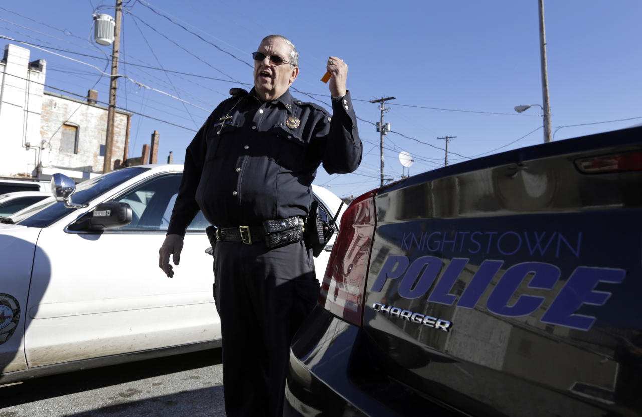 In this Nov. 14, 2013 photo, Knightstown Police Chief Danny Baker talks about the condition of the department's patrol cars outside the station in Knightstown, Ind. Baker is trying to raise money to lease a new car for the department by agreeing to be shot with his Taser. (AP Photo/Michael Conroy)