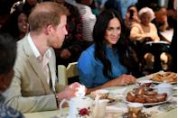 "<p>The Sussex's first trip as a family (although, sadly, Archie didn't make an appearance) was to Africa <a href=""https://www.townandcountrymag.com/society/tradition/g29088194/prince-harry-meghan-markle-royal-tour-africa-photos/"" rel=""nofollow noopener"" target=""_blank"" data-ylk=""slk:for a 10-day trip"" class=""link rapid-noclick-resp"">for a 10-day trip</a>. Here, the new parents sit down to snack on Cape Malay koesisters, which is a local pastry in the area that's similar to a donut. </p>"