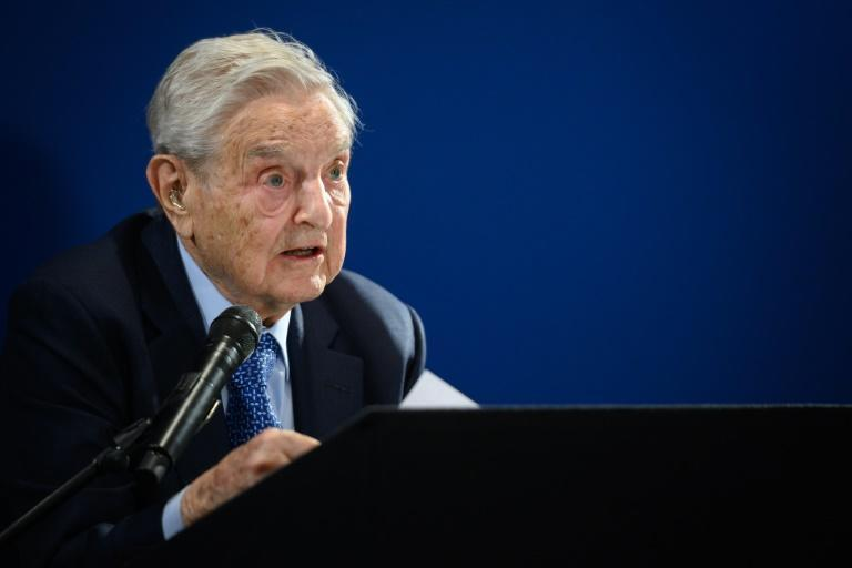 Speaking at the World Economic Forum in Davos, Soros said humanity was at a turning point and the coming years would determine the fate of rulers like President Donald Trump and China's Xi Jinping as well as the world itself (AFP Photo/FABRICE COFFRINI)
