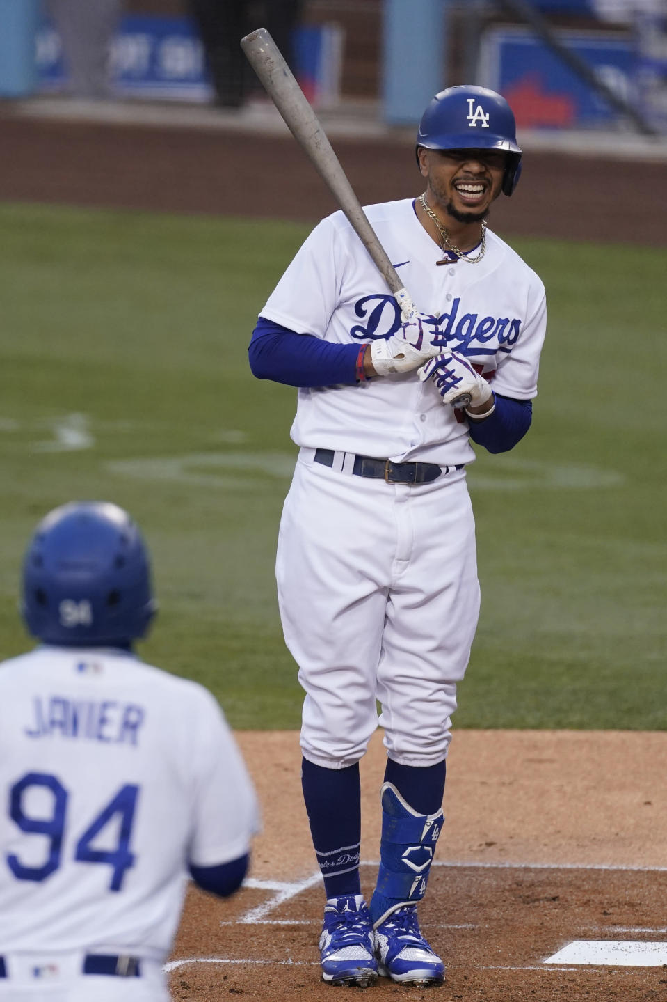 Los Angeles Dodgers' Mookie Betts reacts after being hit with a pitch by Los Angeles Angels starting pitcher Julio Teheran during the first inning of a baseball game Saturday, Sept. 26, 2020, in Los Angeles. (AP Photo/Ashley Landis)