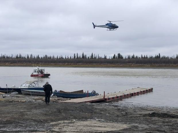 The body of a 29-year-old man was found dead in the water in Inuvik, N.W.T. more than 24 hours after a search and rescue operation began. (Mackenzie Scott/CBC - image credit)