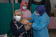Shakeel Ahmed, a doctor, receives a shot of the Covishield vaccine at a primary health center in Srinagar, Indian controlled Kashmir, Tuesday, March 2, 2021. India is expanding its COVID-19 vaccination drive beyond health care and front-line workers, offering the shots to older people and those with medical conditions that put them at risk. (AP Photo/ Dar Yasin)